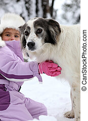 Young girl hugging her dog