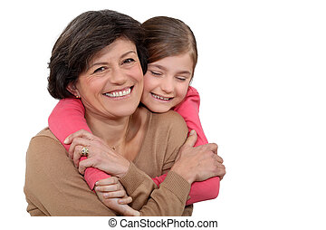 Young girl hugging her grandmother