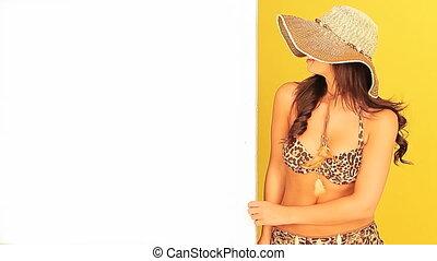 Young girl in a bikini holding