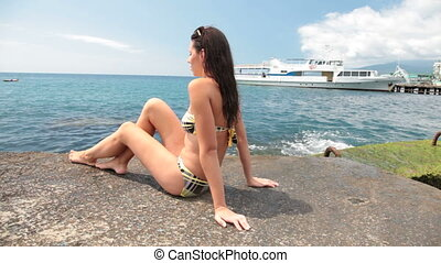 young girl in a bikini on pier