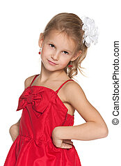Young girl in a fashion red dress