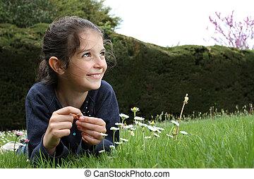 Young girl in a garden