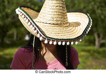 Young girl in a Mexican hat