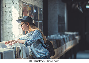 Young girl in a music store