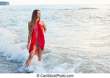 Young girl in a pareo on the sea