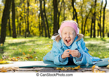 Young Girl in a Park Yawning