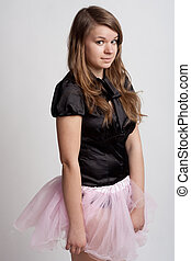 Young girl in a pink skirt