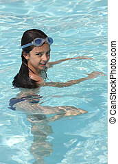 Young girl in a pool