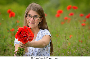 Young girl in a poppy field