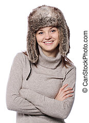 Young girl in a winter hat on white