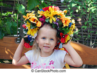 young girl in a wreath