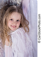 young girl in ballet long white dress