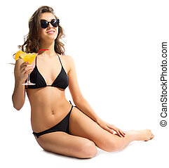 Young girl in bikini with coctail