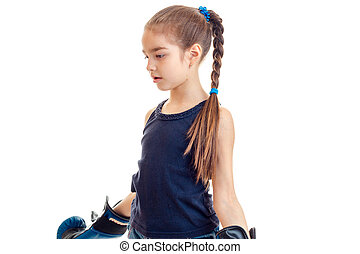 young girl in boxing gloves practicing