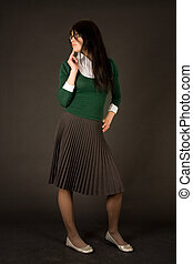 Young girl in business outfit isolated on black background
