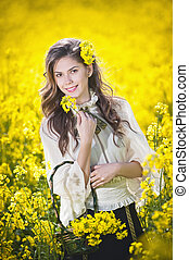 Young girl in canola field