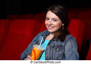 Young girl in cinema watching movie