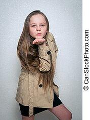 young girl in coat