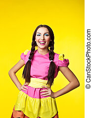 Young girl in doll costume smile on yellow