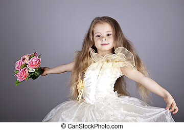 Young girl in dress and flowers.