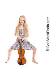 young girl in dress standing with her violin