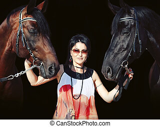 young girl in dress with two horses at black background