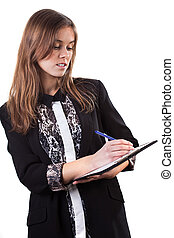 Young girl in elegant clothes making notes