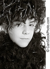 Young girl in feather boa - Young girl costumed with a...