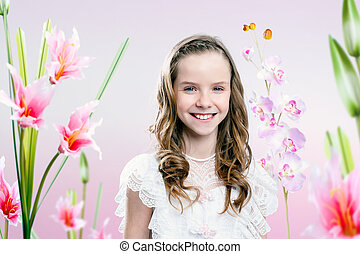 Young girl in flower garden .