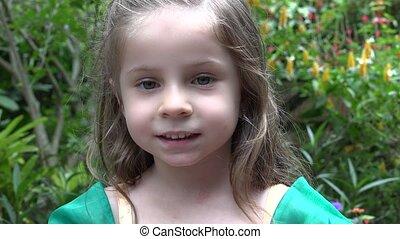 Young Girl in Flower Garden