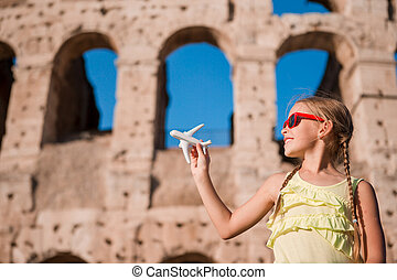 Young girl in front of Colosseum in rome, italy