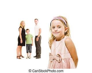 Young girl in front of her family