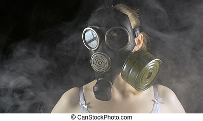 Young girl in gas mask and smoke