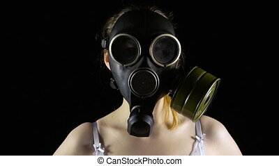 Young girl in gas mask