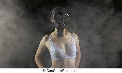 Young girl in gas mask in bra