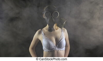 Young girl in gas mask in white bra
