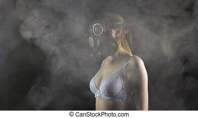 Young girl in gas mask wearing white underwear