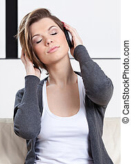 Young girl in headphones listens to music