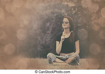 Young girl in indie style clothes with