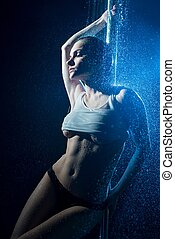 Young girl in lingerie having shower in the dark