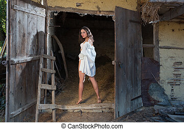 Young girl in old barn