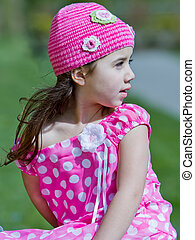 Young girl in pink dress and hat