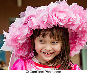 Young girl in pink flower hat