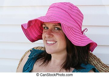 Young girl in pink hat