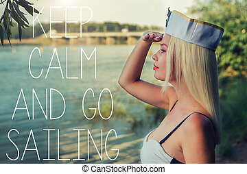 Young girl in pinup sailor form. Keep calm and go sailing.