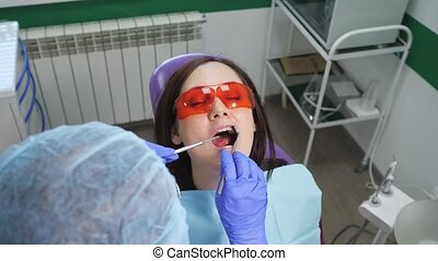 Young girl in protective glasses on preventive examination...