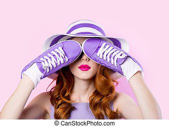 Young girl in purple clothes with shoes
