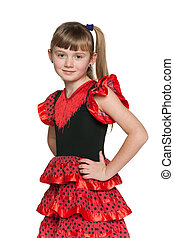 Young girl in red polka dot dress