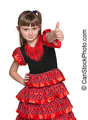 Young girl in red with her thumb up