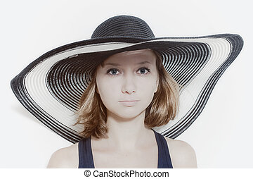 young girl in summer hat closeup